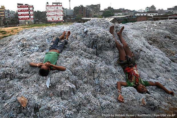 children playing on industrial waste