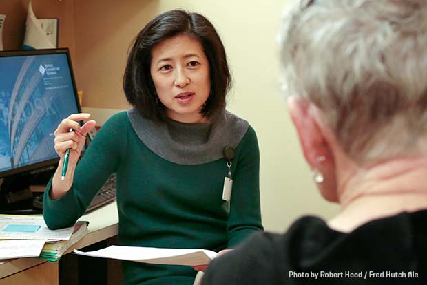 Dr. Sylvia Lee speaks with a patient at Seattle Cancer Care Alliance