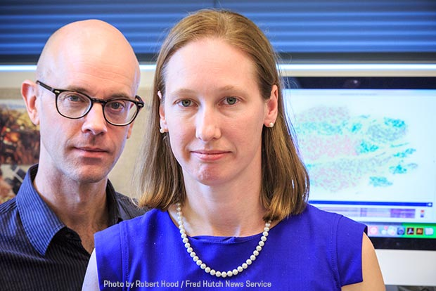 portrait of Drs. Thomas Schmitt and Kelly Paulson in the lab
