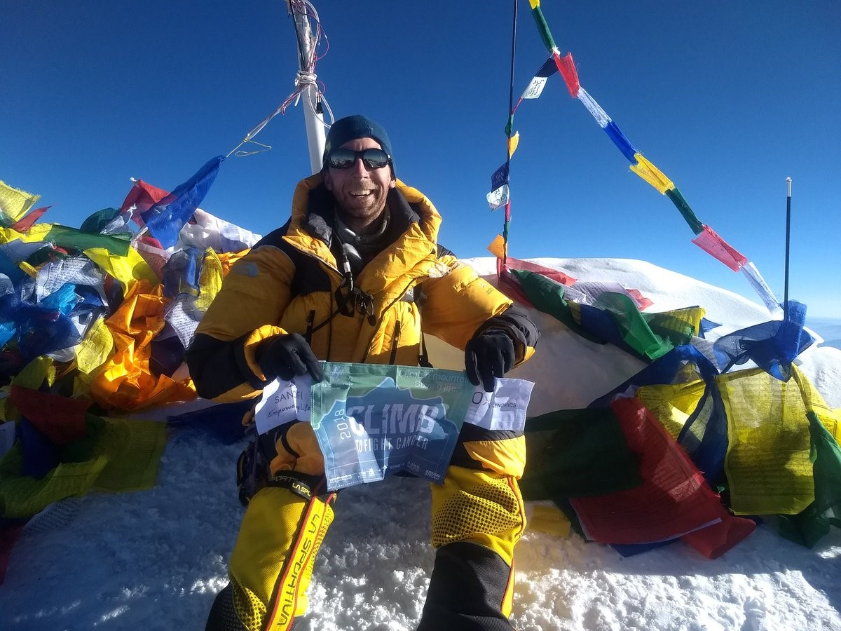 Biotech journalist summits Mount Everest to help cure cancer