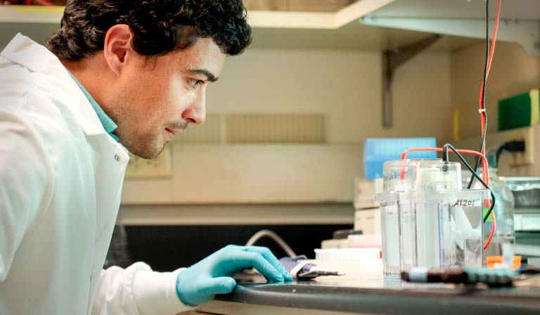 Derek Pacheco sets up a lab procedure in the Hahn Lab on the Fred Hutch campus.