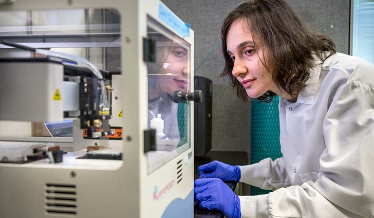 Research Associate Hatch Seda Kaya-Okur works the robotic pipette machine in the Henikoff Lab at Fred Hutch.