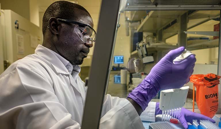 Specimen is being prepared at molecular diagnostic lab at UCI-Fred Hutch Cancer Centre by Lazarus Okoche