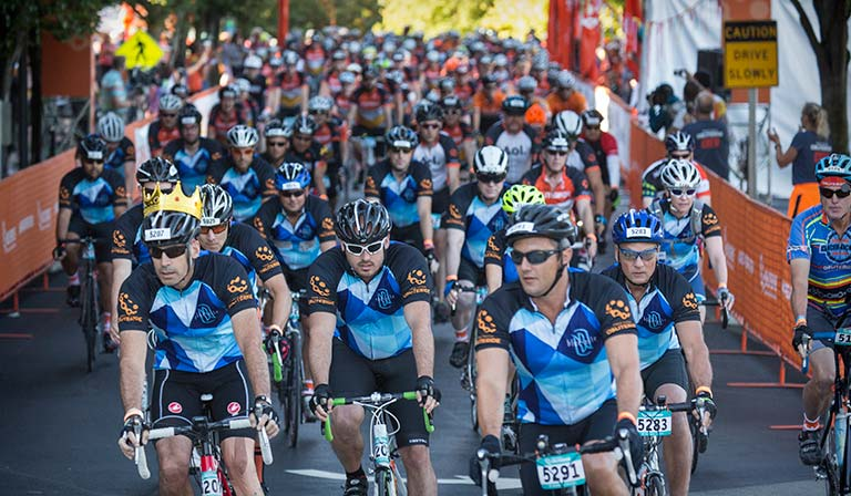 Obliteride riders pull away from the starting line at Fred Hutch's Seattle campus. Participants raise money through donations for cancer research.