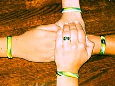 the hands of Glory, her mother and friends wearing wristbands