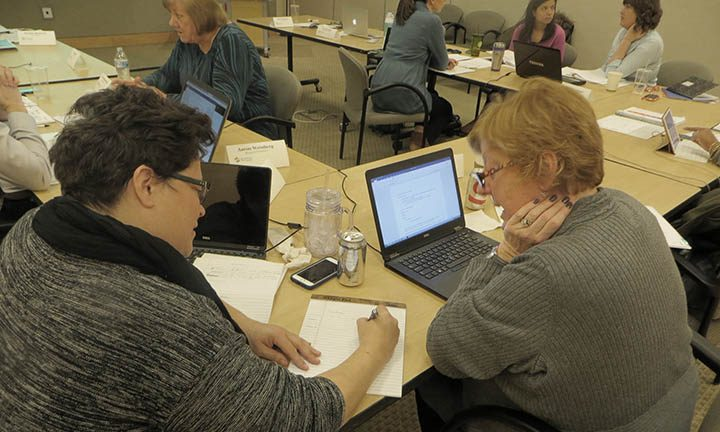 Dr. Rachel Ceballos of Fred Hutch (left) works with Barb Fox from the Carol Milgard Breast Center during a grant-writing workshop at the Hutch.