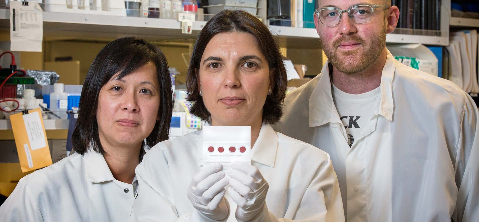 Leukemia researchers (from left) Lan Beppu, Dr. Olga Sala-Torra and Jordan Smith with a low-cost tool for diagnosing chronic myeloid leukemia.