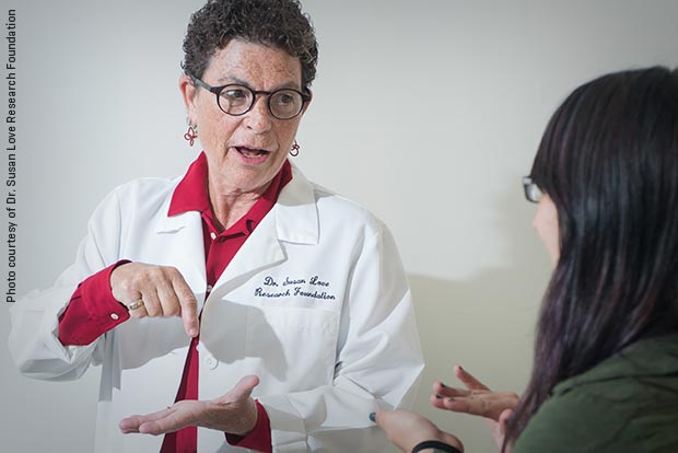 Dr. Susan Love shown in the clinic, talking to a patient