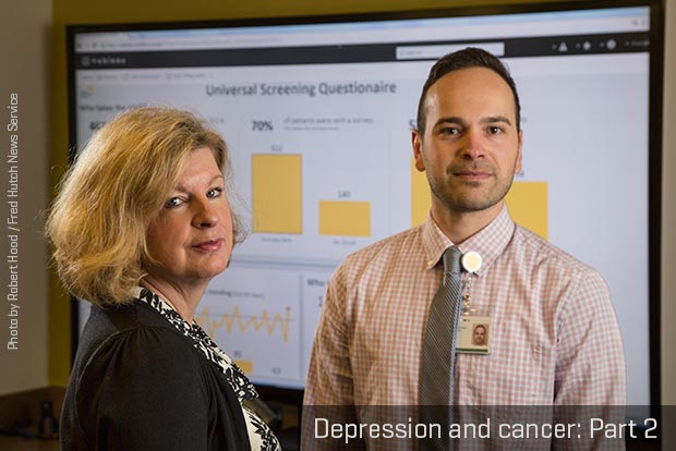 Seattle Cancer Care Alliance's Moreen Dudley and Petr Horak standing in front of a screen projecting a depression screening questionnaire