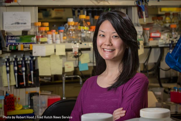 Postdoctoral researcher Dr. Minna Roh-Johnson standing in a laboratory at Fred Hutch