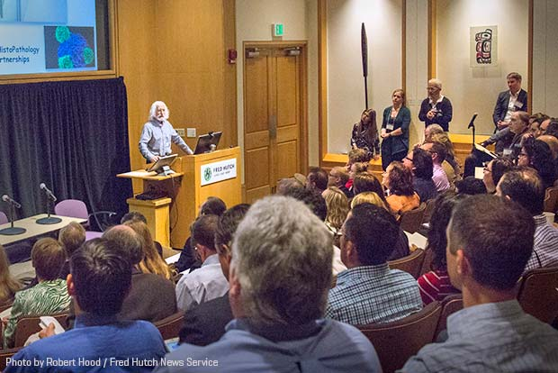Photo of Dr. Phil Greenberg speaking at immunotherapy forum at Fred Hutch