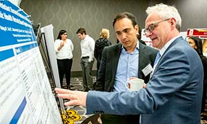 Dr. Michael Boeckh, right, at a poster session